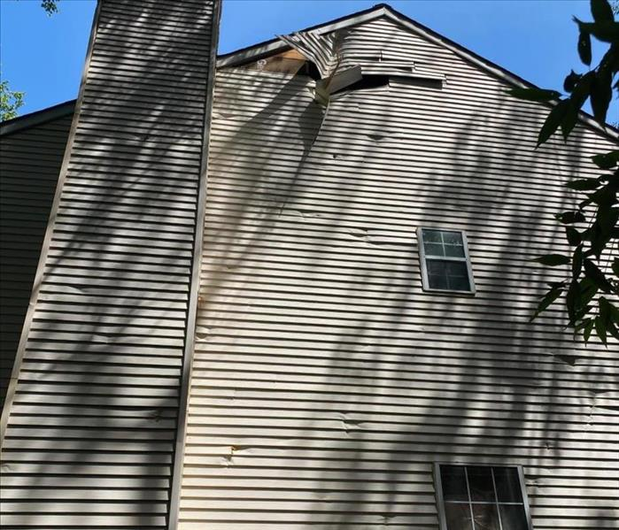 Siding falling off house