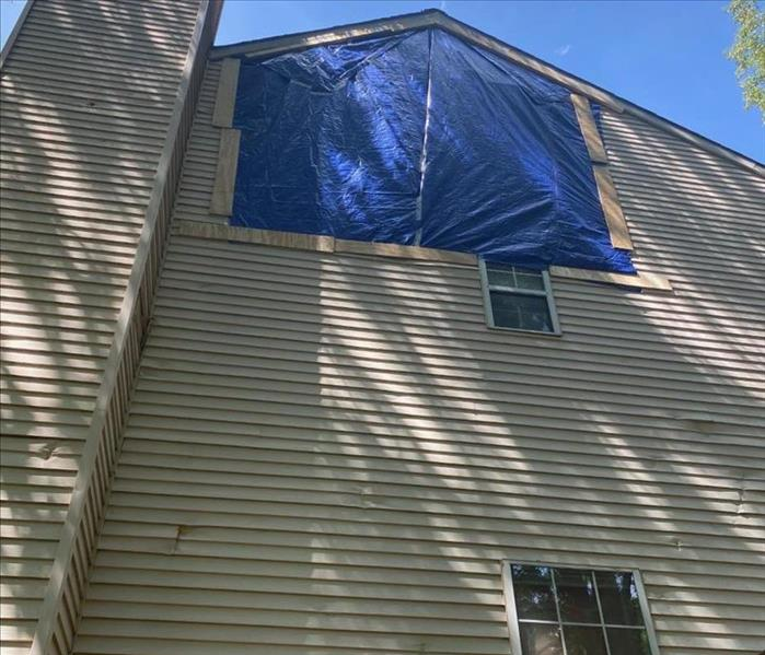 Tarp on siding