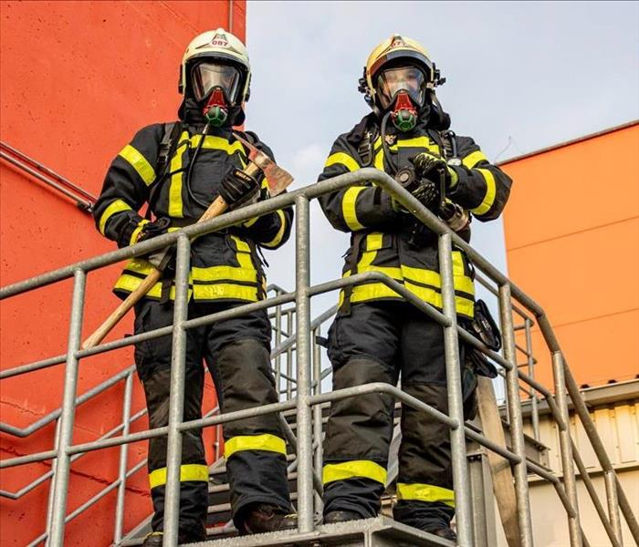 Firefighters standing