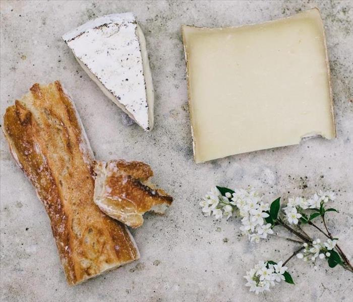 Aged cheese, bread, and a flower