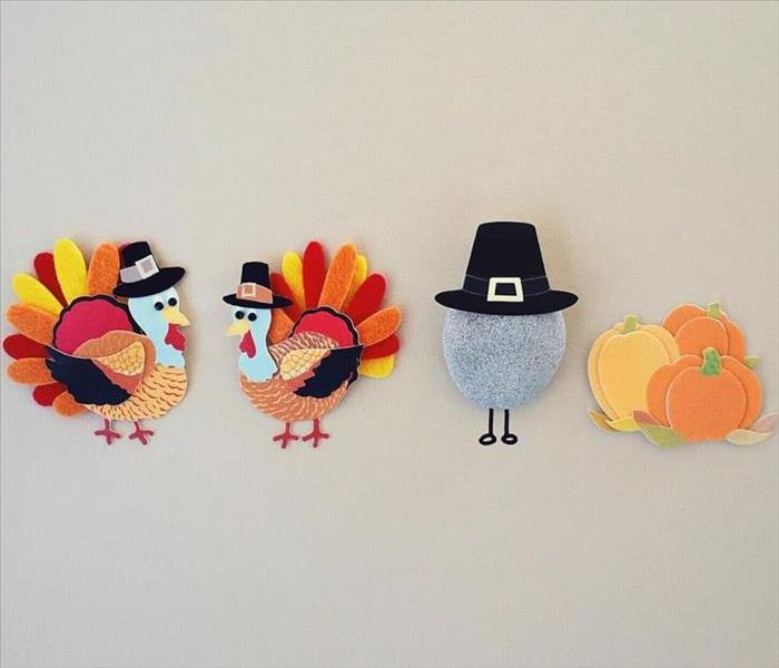 Two turkey, a pilgrim, and three pumpkins cutouts