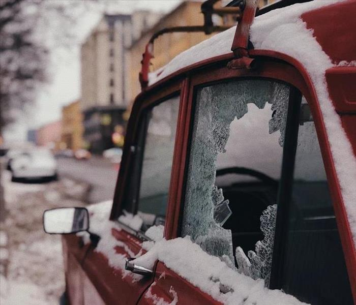 Car with broken window in snow