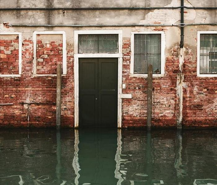 Floodwaters and partially brick building